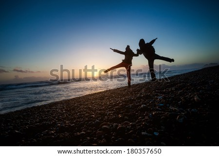 Romantic photo of couple during sunset, made in Brighton, England