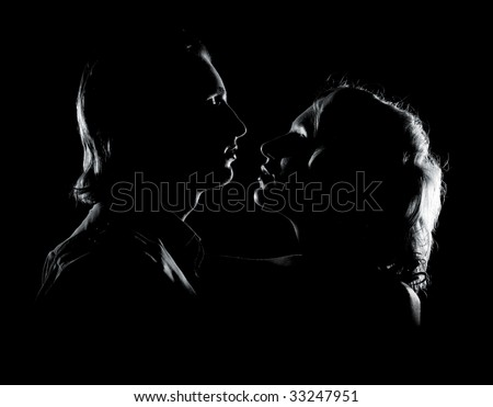 romantic picture of young couple in darkness