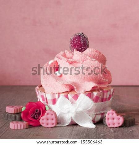 Romantic pink cupcake with cookie hearts