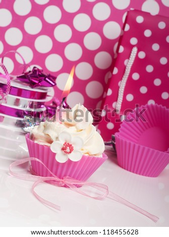 romantic pink cupcake with swirl and bow