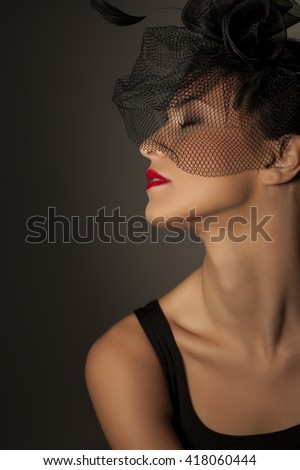Romantic portrait of beautiful young woman with veil hat