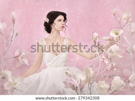 Romantic portrait of bride, white flowers, snow falling... ( real studio setting ) - stock photo
