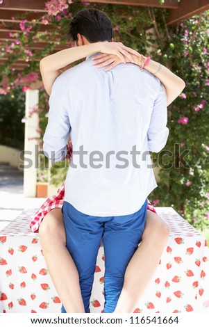 Romantic Portrait Of Couple Embracing Outdoors - stock photo
