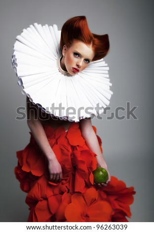 Romantic portrait of red hair Woman with white Jabot and red bright Dress. Creative concept