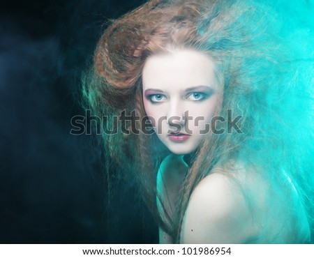 Romantic portrait of redhair woman in smoke