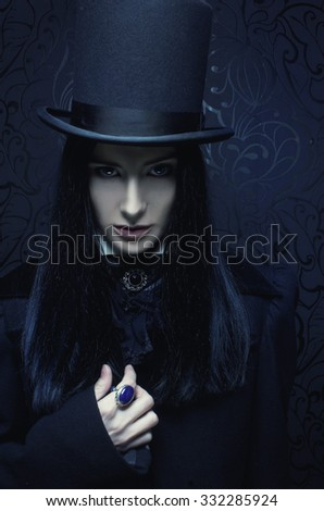 Romantic portrait of young woman in gothic man image. - stock photo