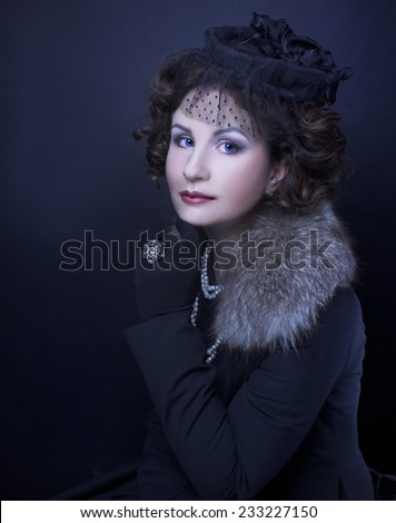 Romantic portrait of young woman in retro style. - stock photo