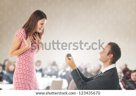 Romantic proposal scene with happy woman and man. - stock photo