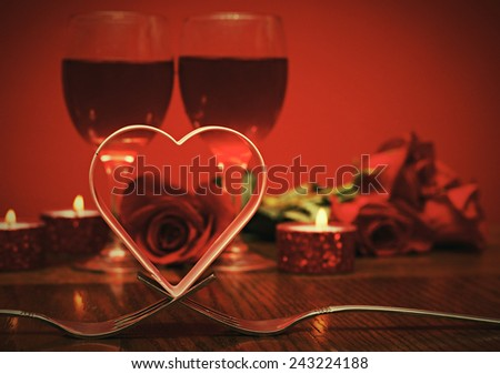Romantic retro card a metal heart over forks for love idea. Valentines day - stock photo