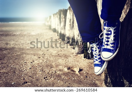 Romantic seascape with relaxing teenager  - stock photo