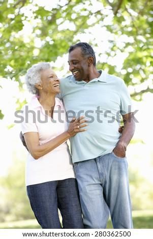 Romantic Senior African American Couple Walking In Park - stock photo