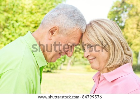 Romantic senior couple enjoying the moments together outdoors. - stock photo