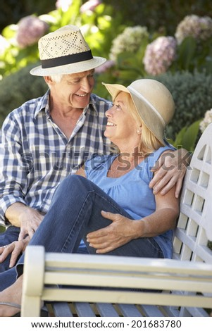 Romantic senior couple relaxing in garden - stock photo