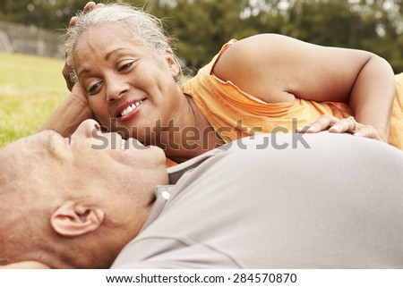 Romantic Senior Couple Relaxing In Park Together - stock photo
