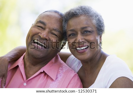Romantic senior couple relaxing outside - stock photo
