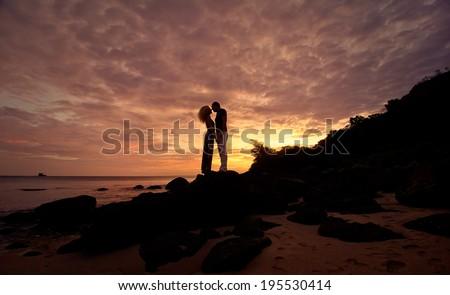 Romantic silhouette of a loving couple on honeymoon - stock photo