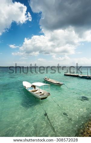 romantic Small boats on nusa penida beach, Bali Indonesia with blue sky, tranquil scene - stock photo