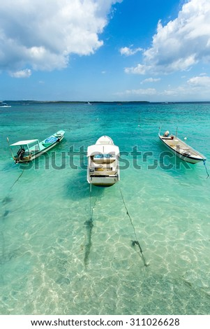 romantic Small boats on nusa penida beach, Bali Indonesia with blue sky, tranquil scene in pastel color - stock photo