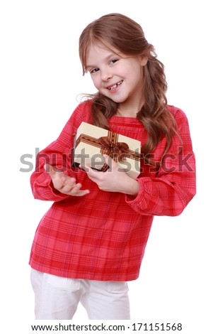 romantic smiling girl holding present over white background - stock photo