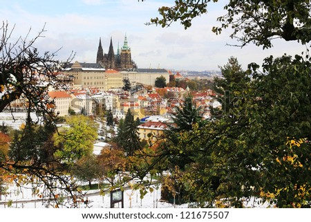 Romantic snowy colorful autumn Prague gothic Castle, Czech Republic