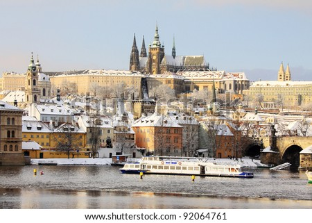 Romantic Snowy Prague gothic Castle above the River Vltava in the sunny Day