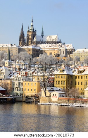 Romantic Snowy Prague gothic Castle above the River Vltava in the sunny Day, Czech Republic