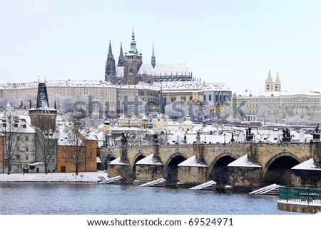 Romantic Snowy Prague, gothic Castle with the Charles Bridge