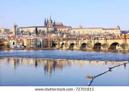 Romantic Snowy Prague gothic Castle with the Charles Bridge,  Czech Republic - stock photo
