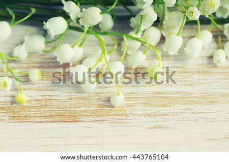 Romantic spring bouquet lilies of the valley on a wooden background, close up.  - stock photo