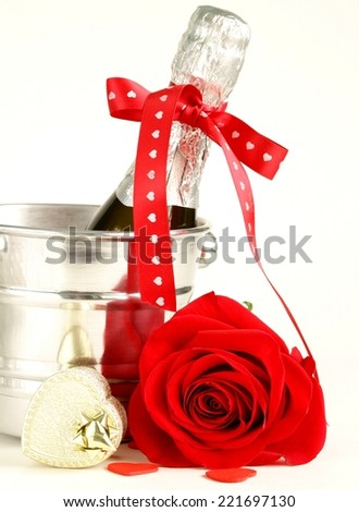 romantic still life champagne, roses, gifts - stock photo