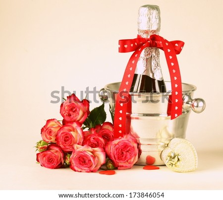 romantic still life champagne, roses, gifts, chocolate (toned in retro style) - stock photo