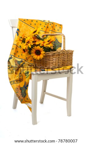 Romantic still life with a basket sunflowers on a white chair with French Provence design