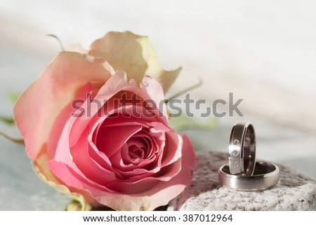 Romantic still life with a Rose and wedding rings