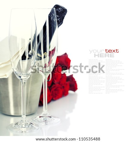 Romantic still life with champagne and beautiful red roses over white (with easy removable text) - stock photo