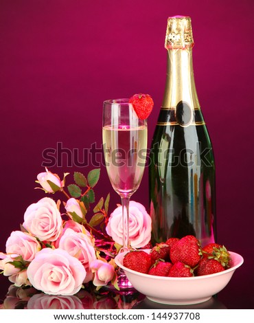 Romantic still life with champagne, strawberry and pink roses, on dark color background - stock photo