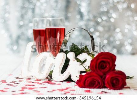 Romantic still life with pink champagne and beautiful red roses. Valentine's day concept.Soft focus