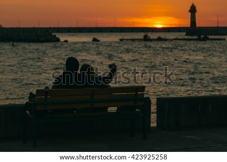 romantic sunset on the sea promenade.