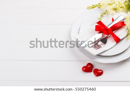 Romantic table setting on white wooden stock photo 549541321 romantic table setting on white wooden tablelentines day card template pronofoot35fo Image collections