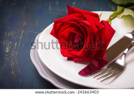 Romantic table setting with red rose