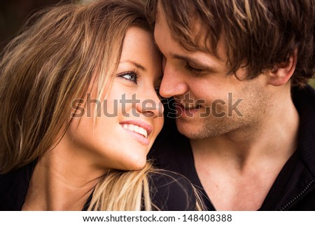 Romantic, tender moment of a young attractive couple. close up portrait - stock photo