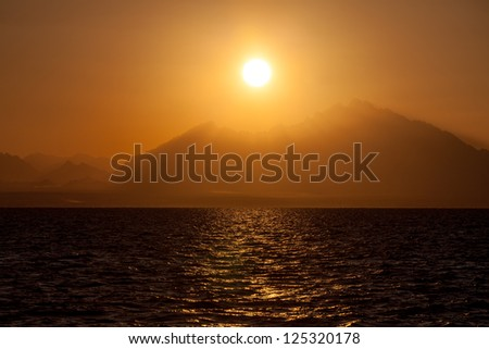 Romantic View of a Sunset over a Mountains - stock photo