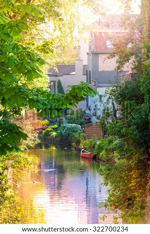 Romantic view of the canal with red boat in Bruges