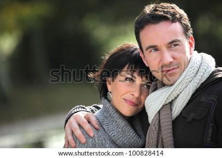Romantic walk through the woods - stock photo