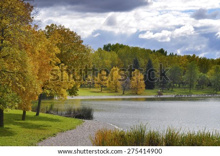 romantic walking path in the lake side in autumn - stock photo