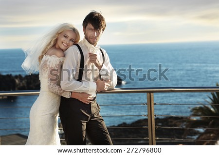 Romantic wedding couple on sea-coast - stock photo