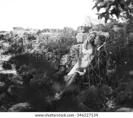 Romantic wedding couple outdoor, black-n-white - stock photo