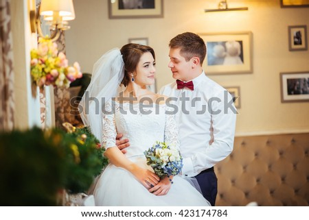 Romantic wedding couple together. Photo session in interior