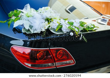 Romantic Wedding Decoration Flower on Wedding Car in Black and White. - stock photo