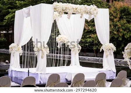 romantic white wedding table set up on tropical beach,wedding set up - stock photo