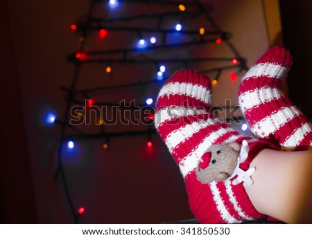 romantic winter evening by the fireplace Christmas and Christmas tree,horizontal photo - stock photo